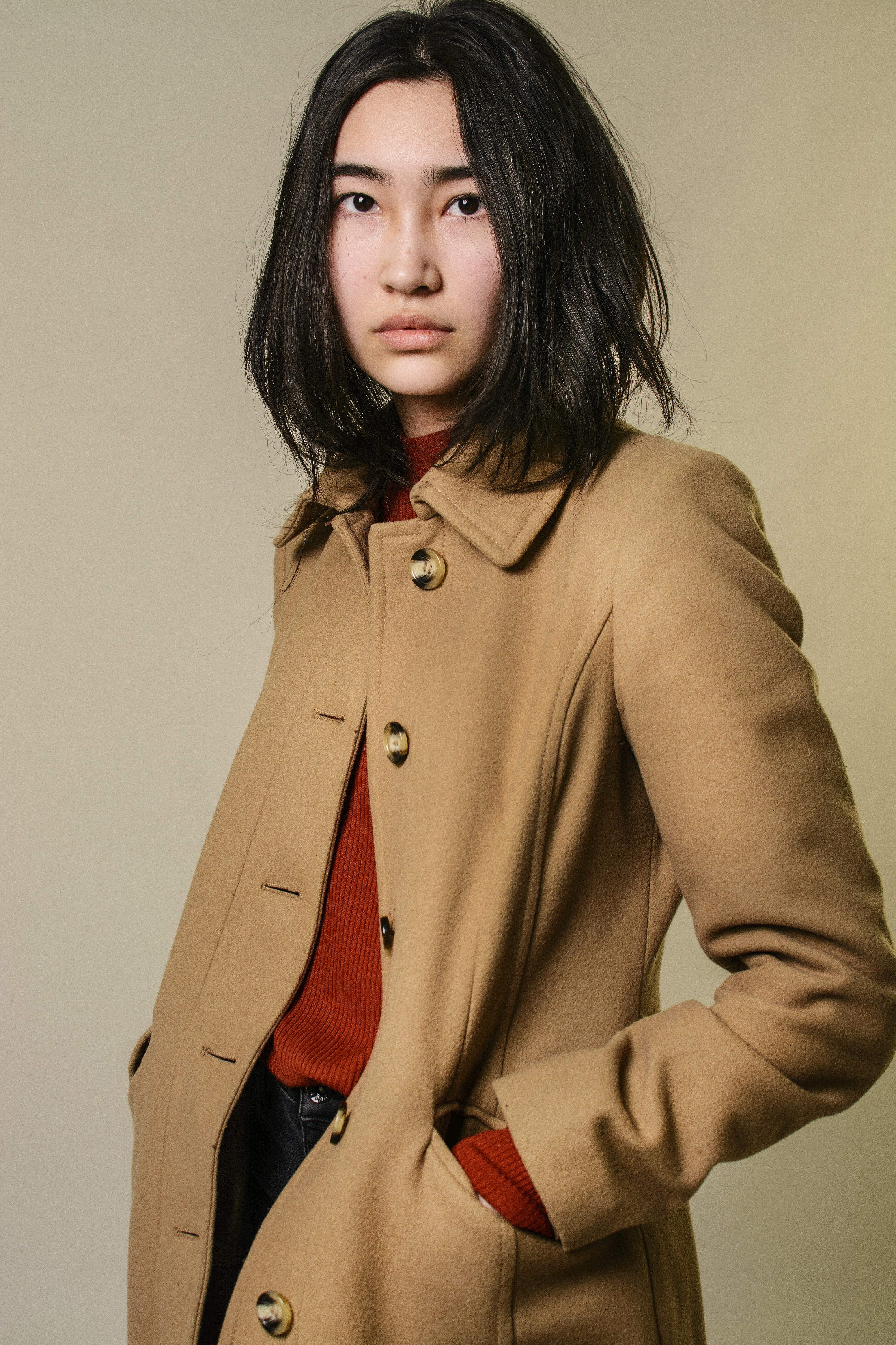 woman wearing brown button-up coat