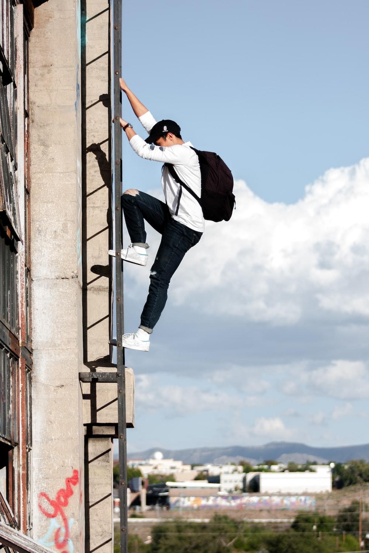 man climbing building using emergency stairs