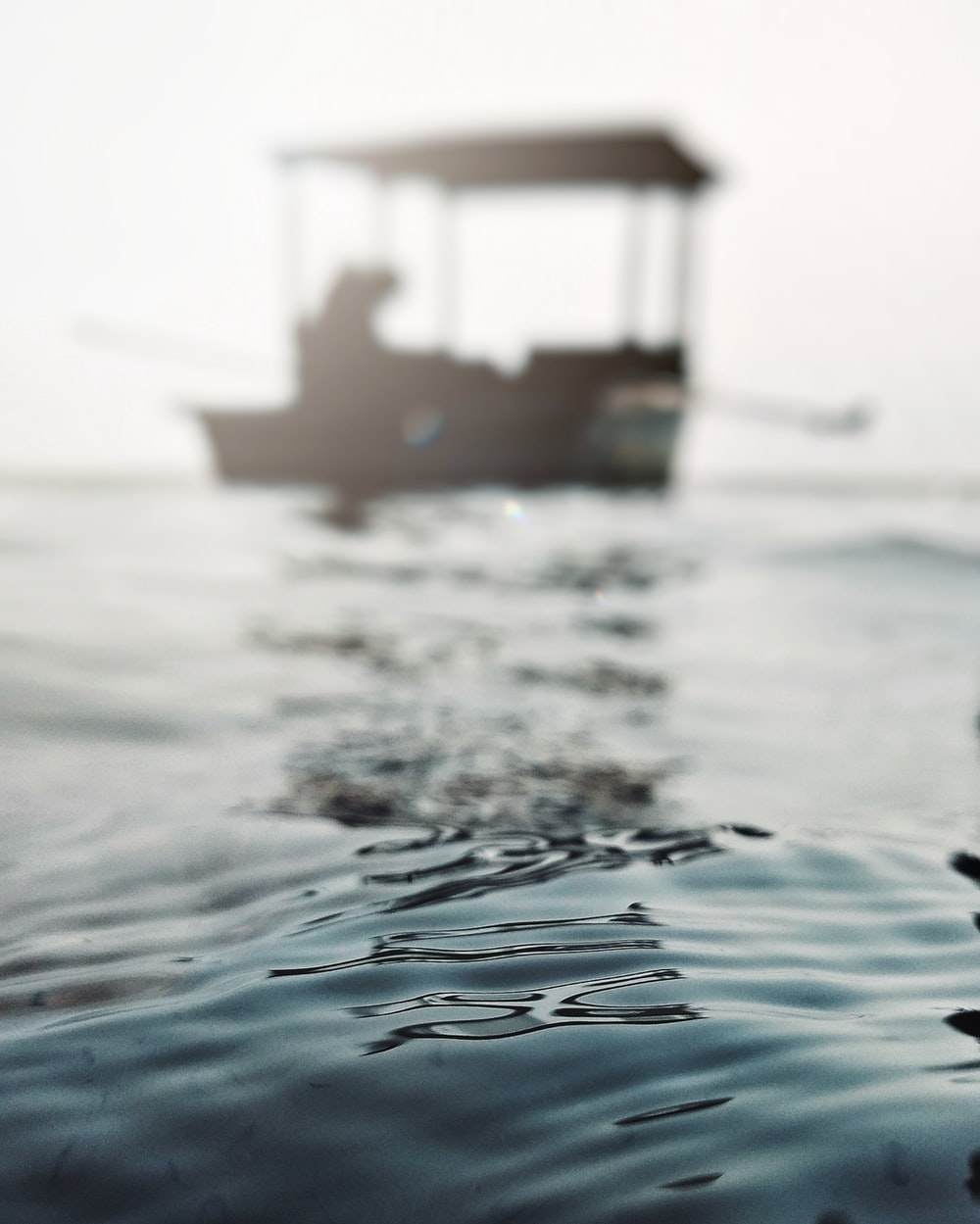selective focus photography of boat on body of water during daytime