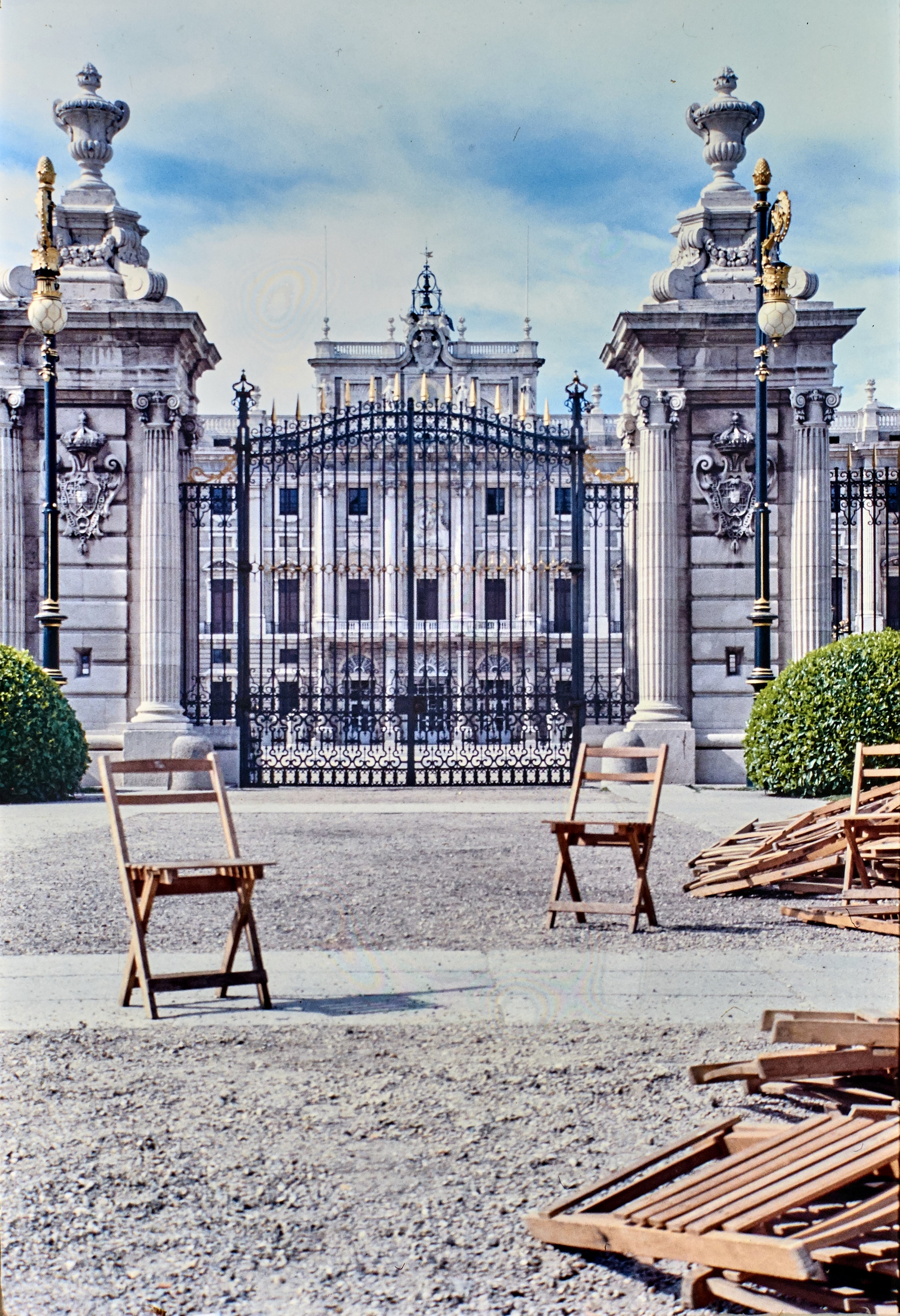 two brown wooden folding chairs near gate