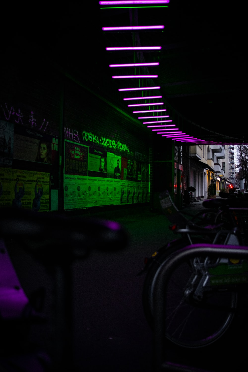 dim lighted room with green and purple lights
