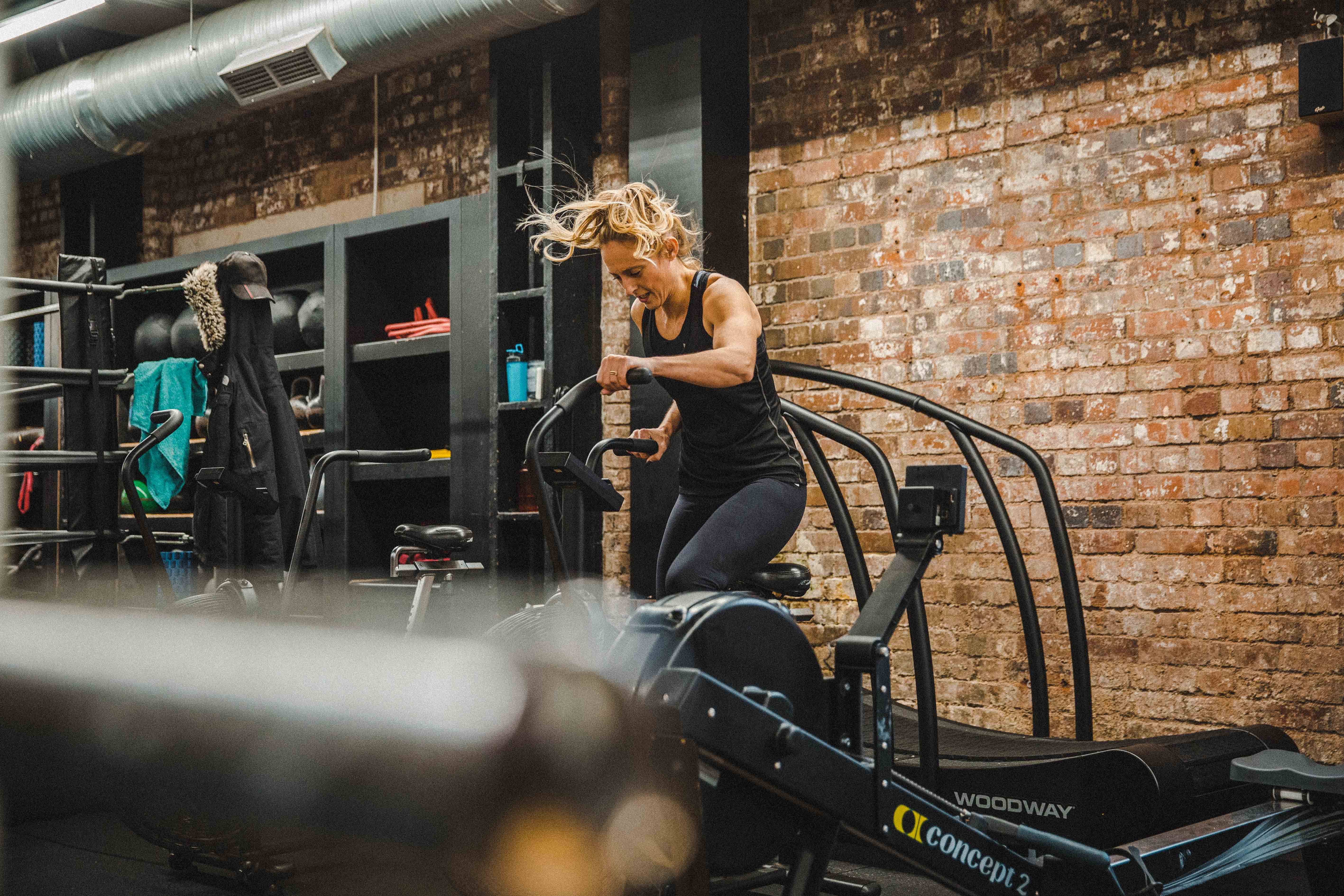 woman using exercise equipment at gym