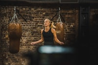 woman in black fitness top doing training