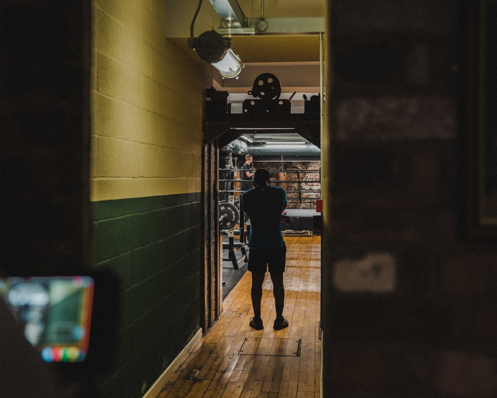 man standing inside lighted room