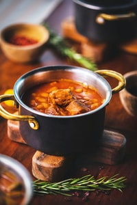 cooked dish in black cooking pot