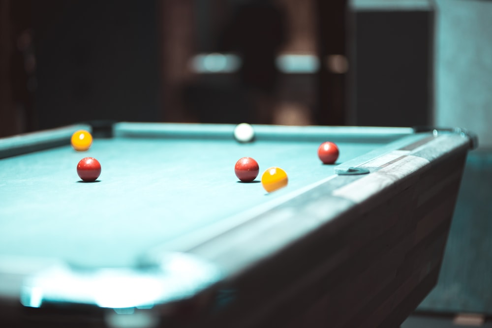 selective focus photography of pool table