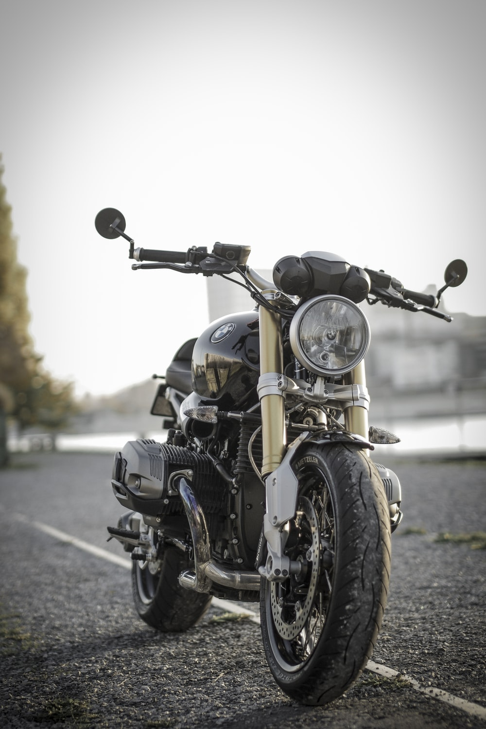 black bobber bike parked on road during daytime
