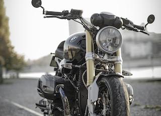 black bobber bike parked on road during daytime