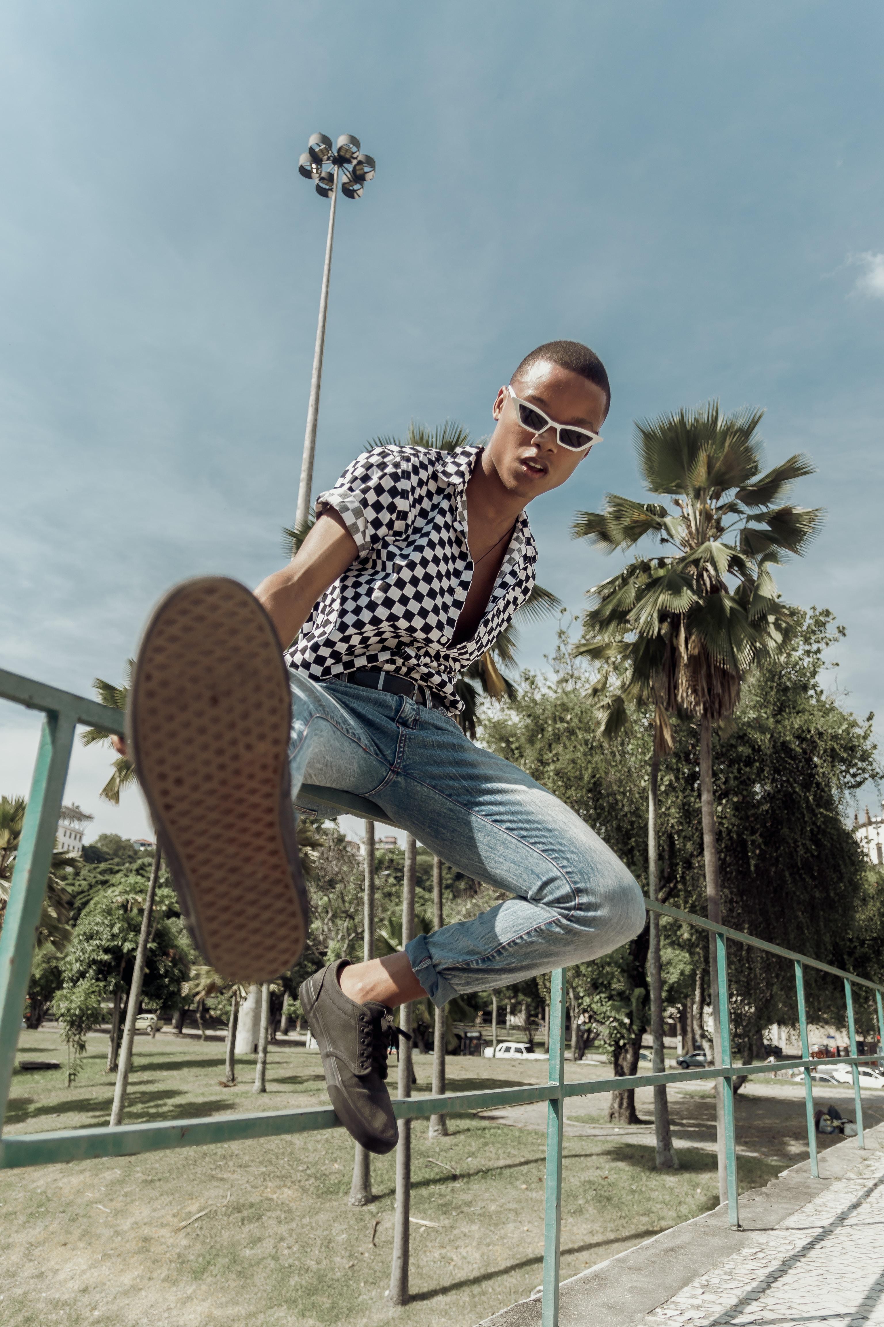 man sitting on railing