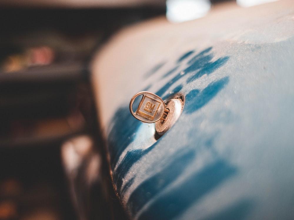 blue GM vehicle key in vehicle keyhole