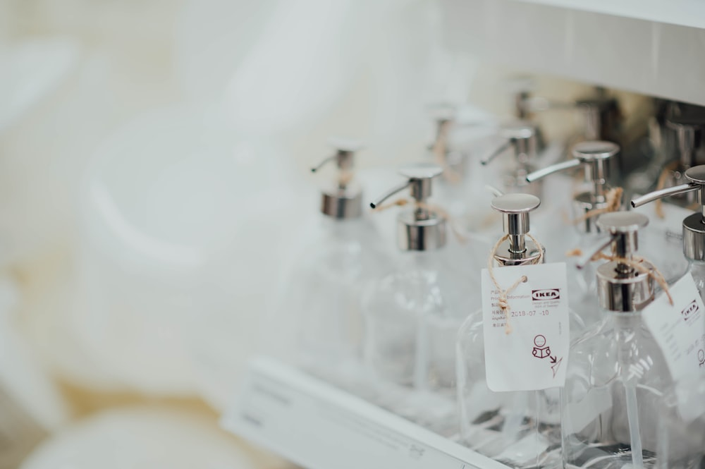 pump bottles on tray in selective focus photography