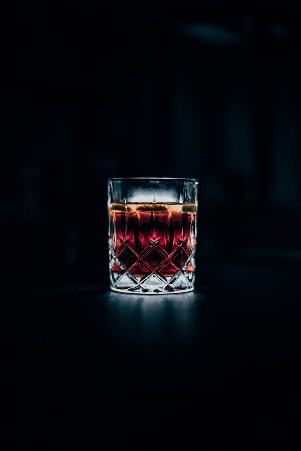 clear drinking glass filled with red liquid