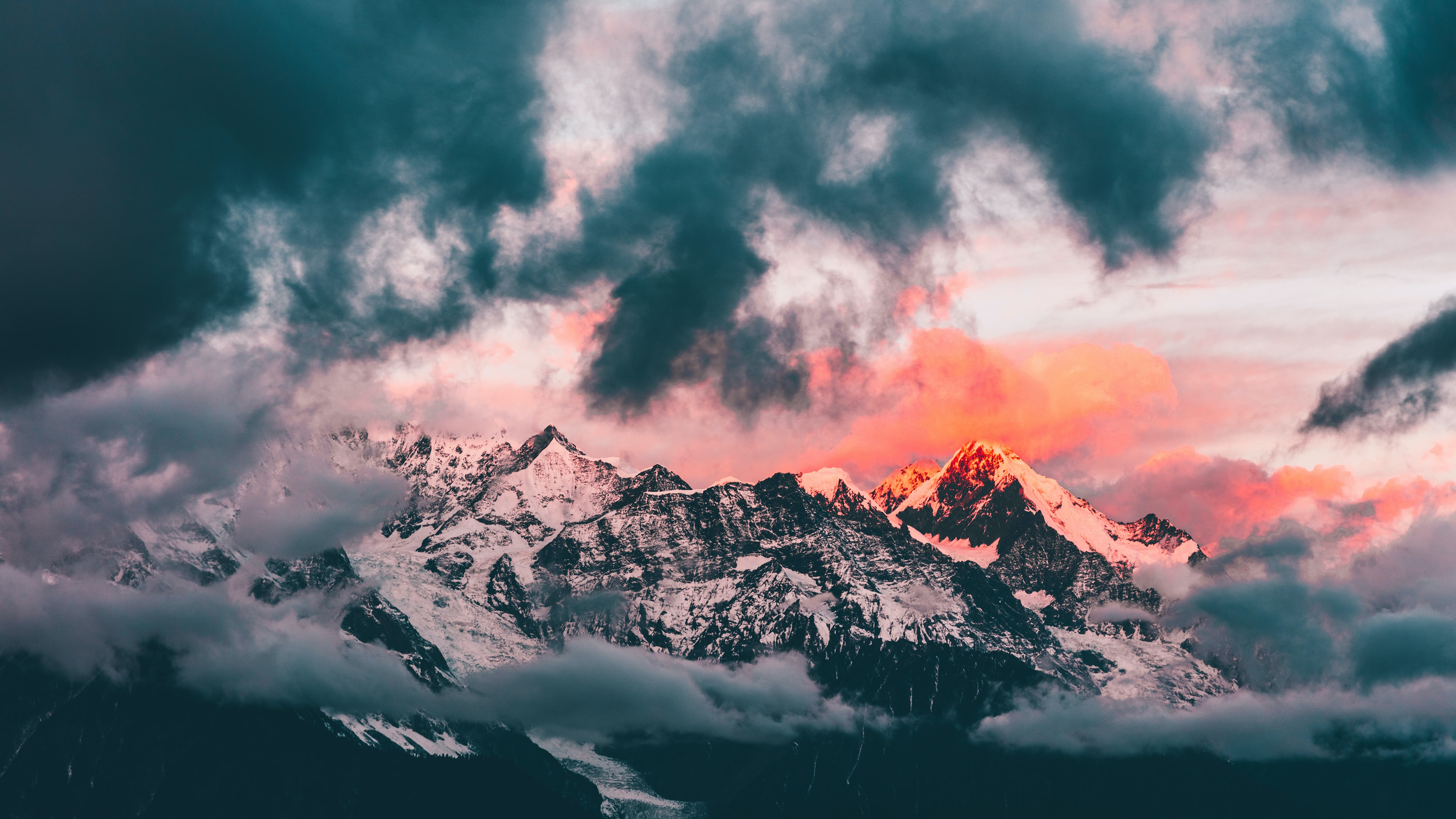 iced-capped mountain under stormy sky