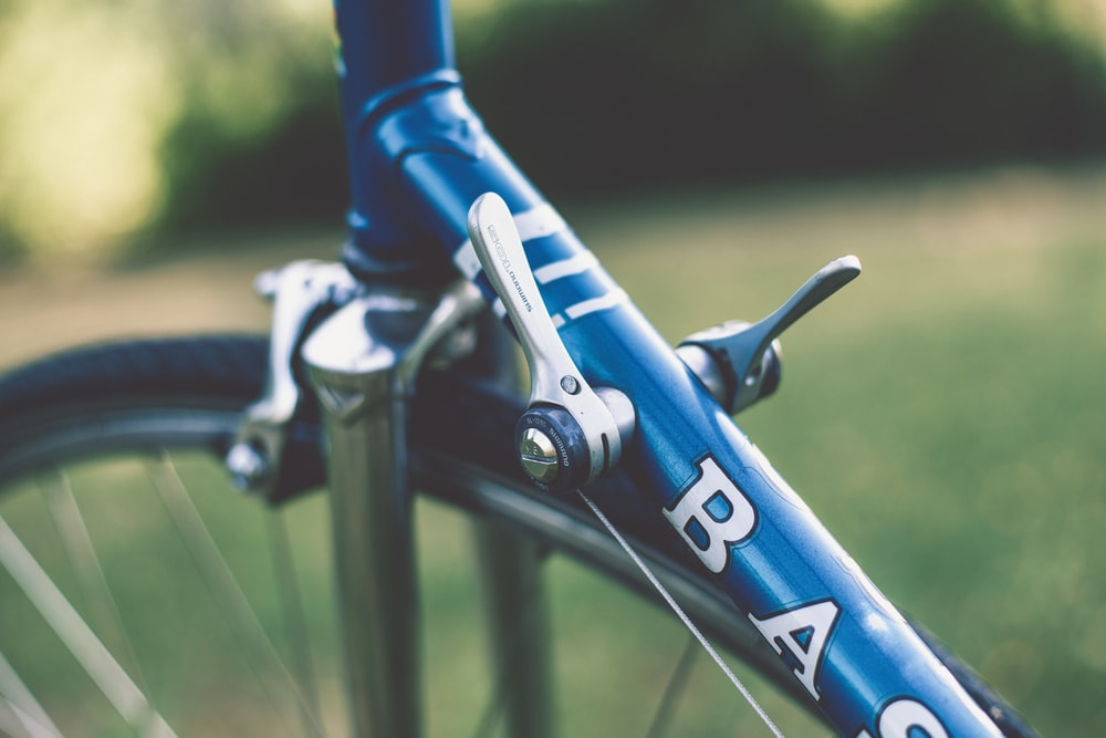 selective focus photography of bicycle