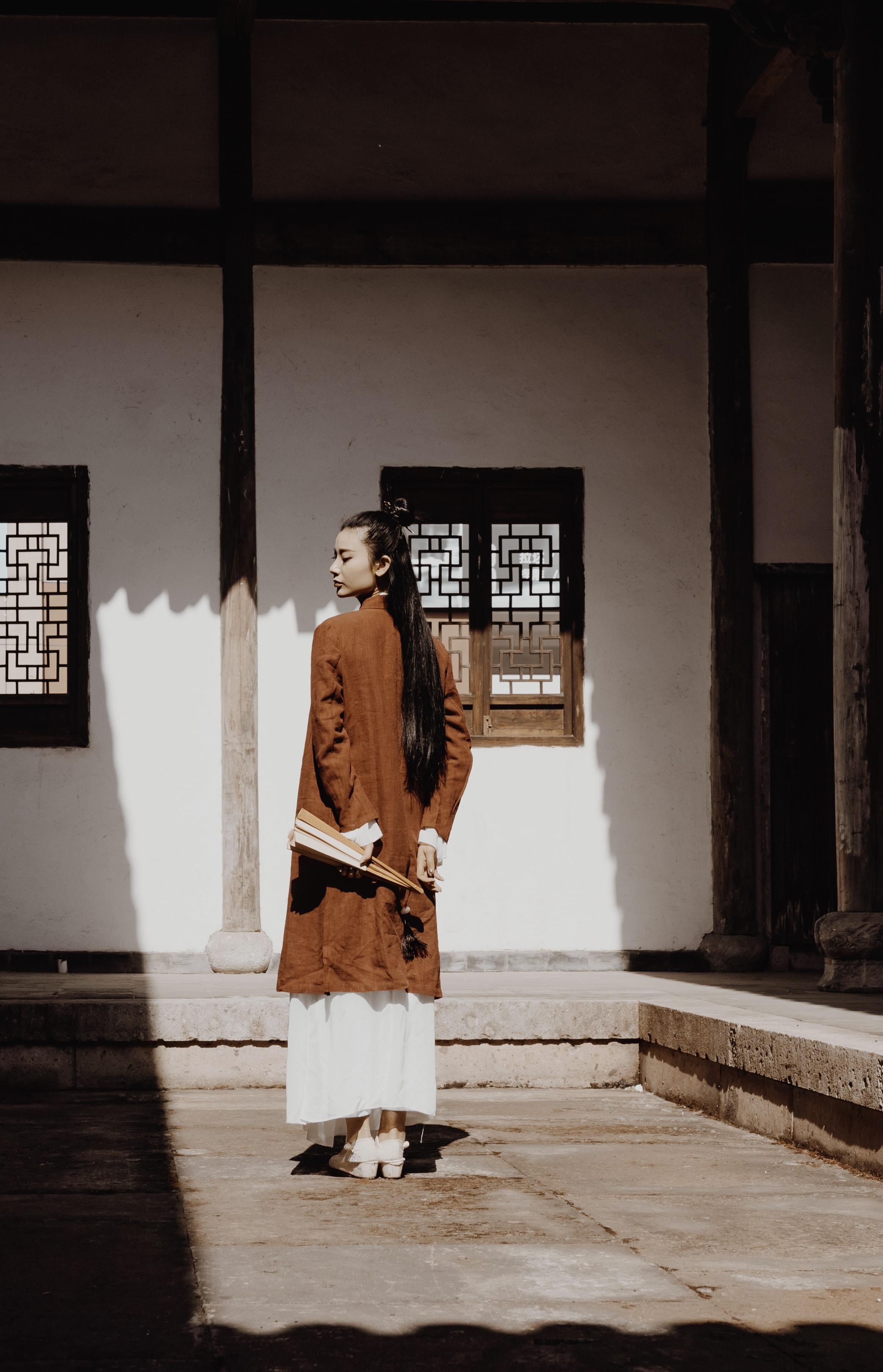 woman in brown long-sleeved dress