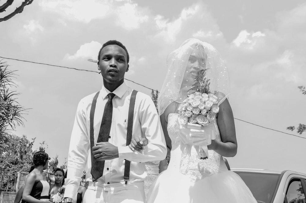 grayscale photo of newlywed couple