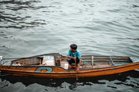 woman paddling at orange boat