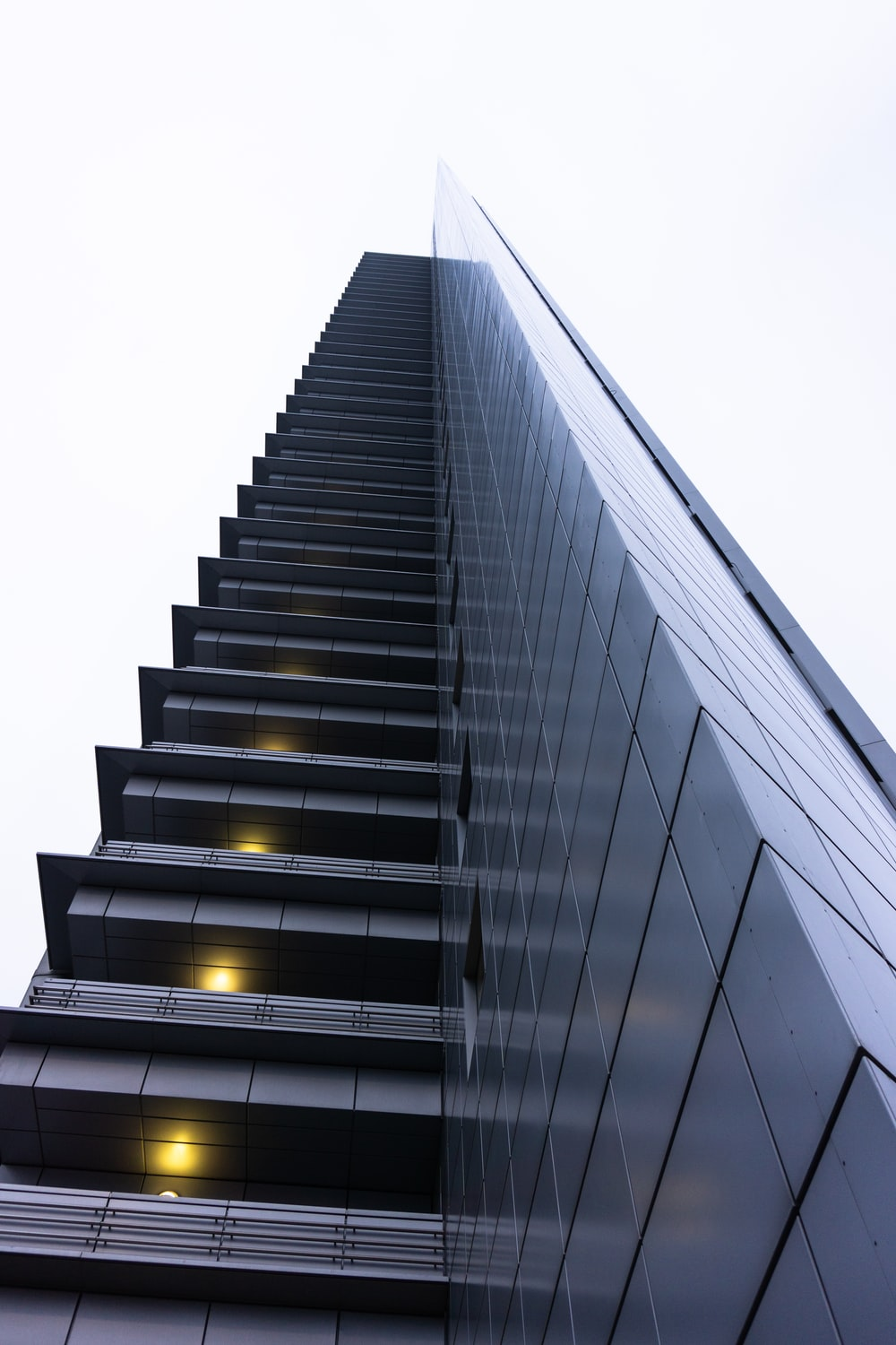 low angle photography of gray high rise building
