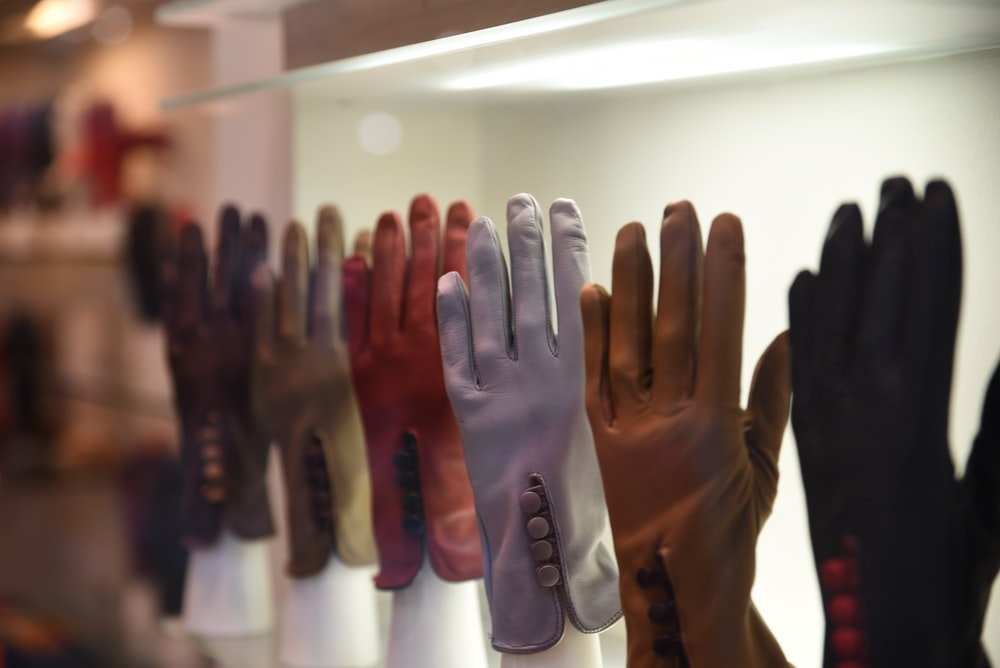 assorted-color gloves on display