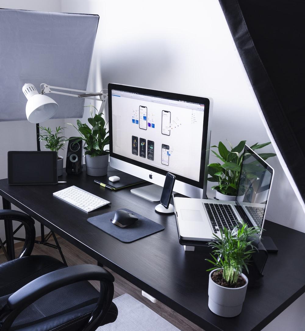 silver iMac beside MacBook Pro