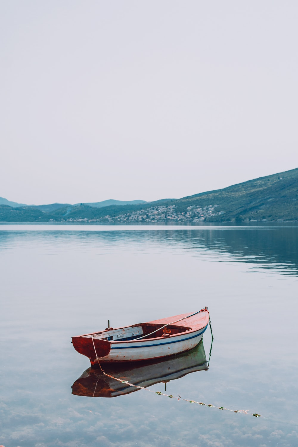 empty boat on lake during daytime