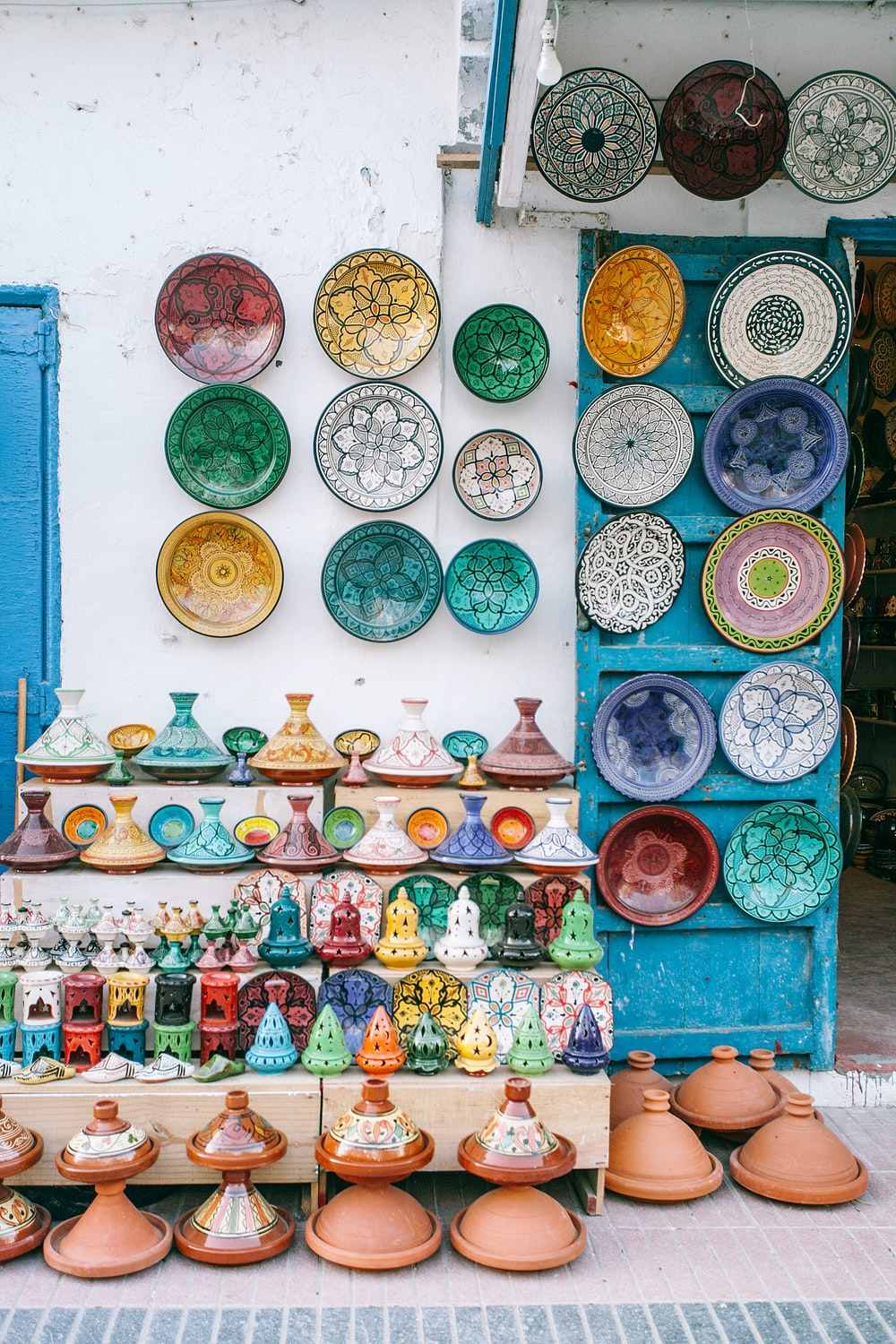flower pots and decorative plates on wall