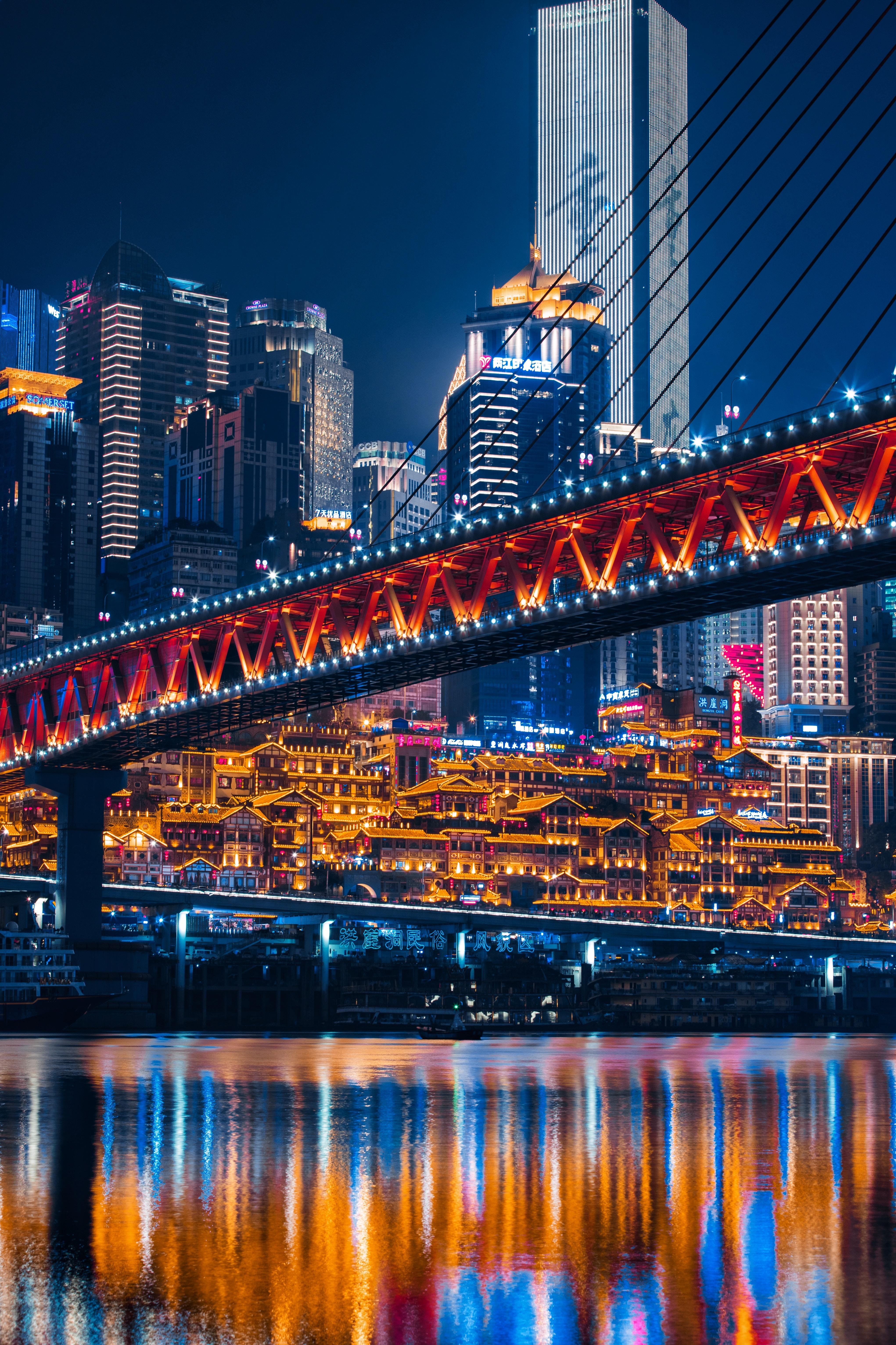 lighted bridge across calm water