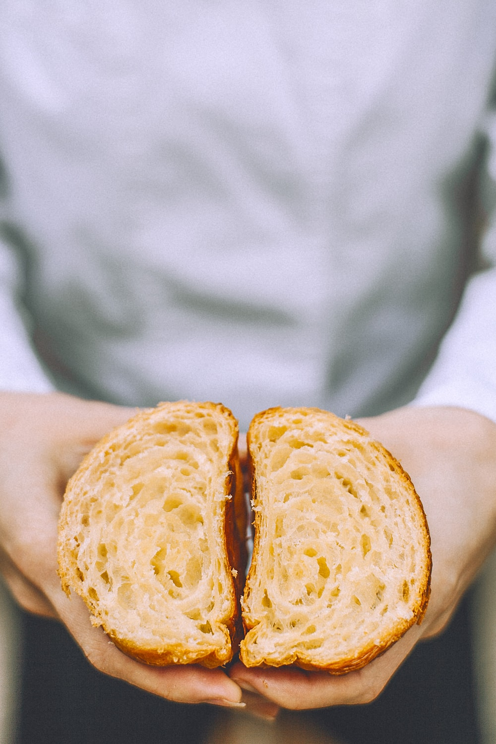 person holds two sliced bread