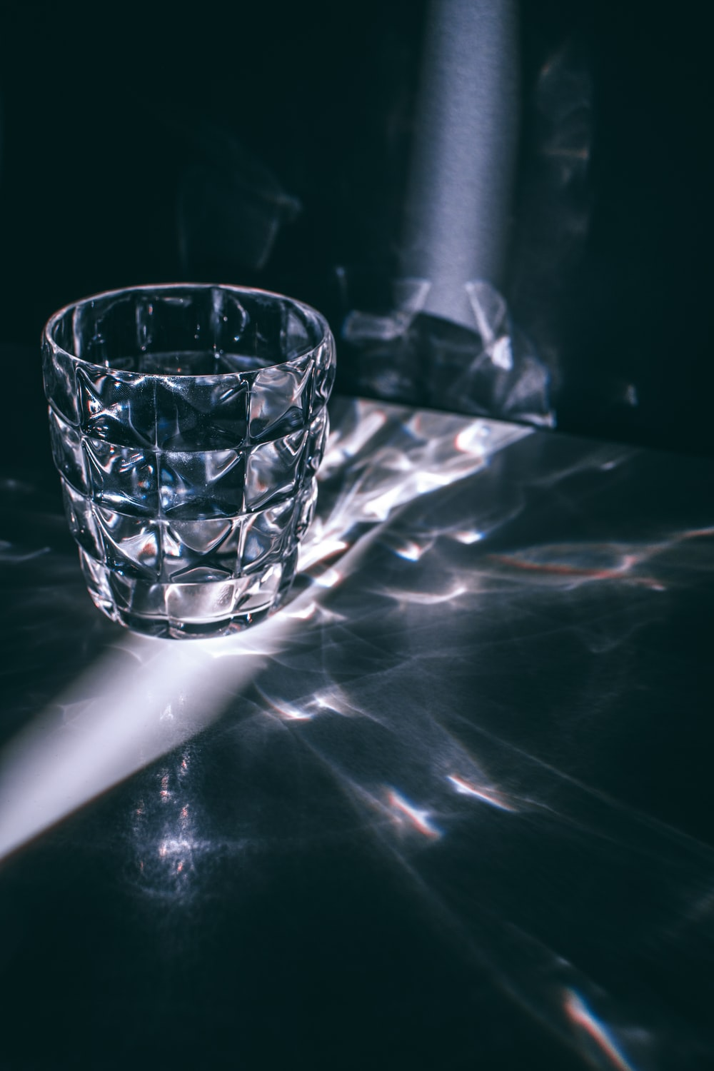 empty cup on white surface with light reflection