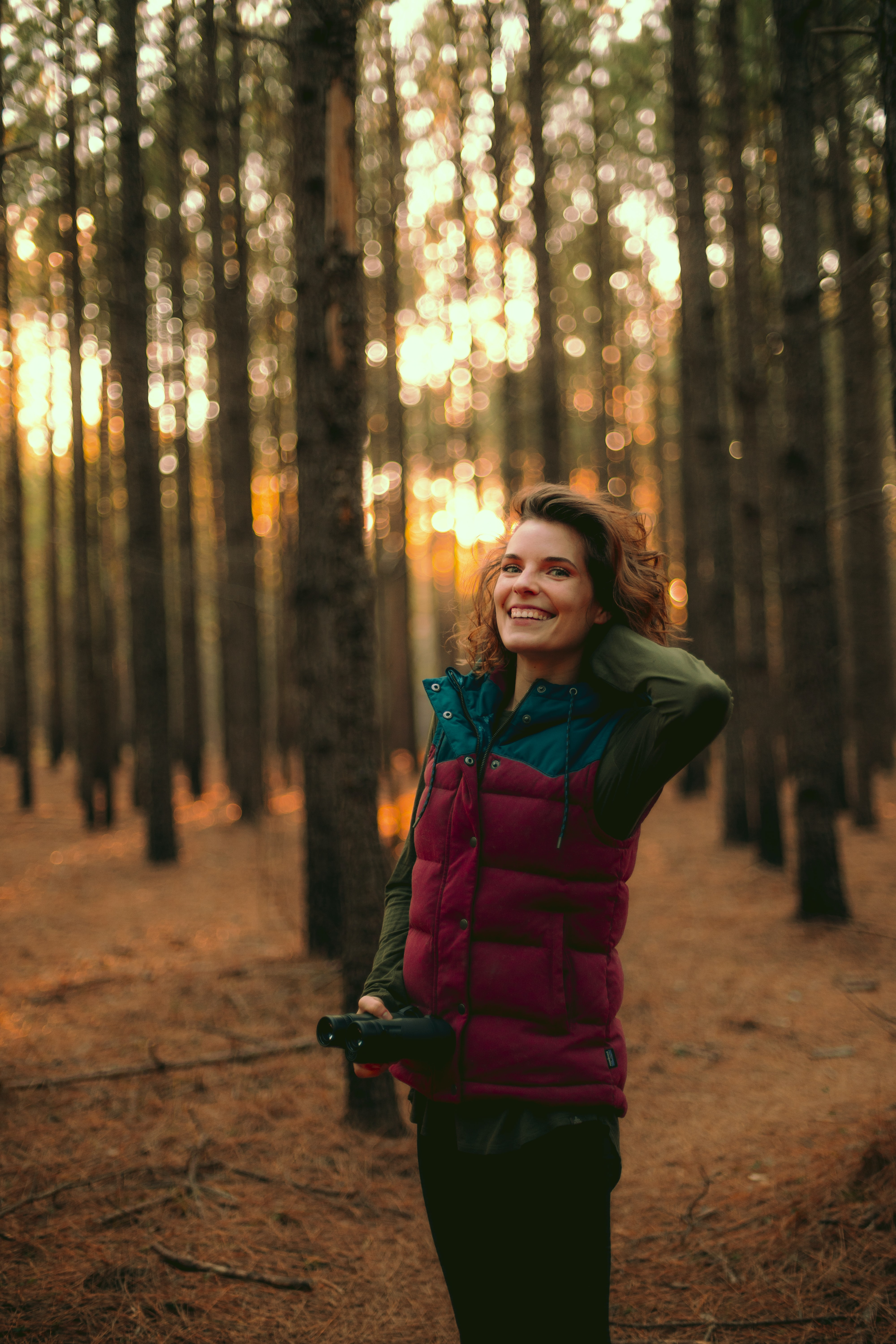 woman standing on forest during golden hour
