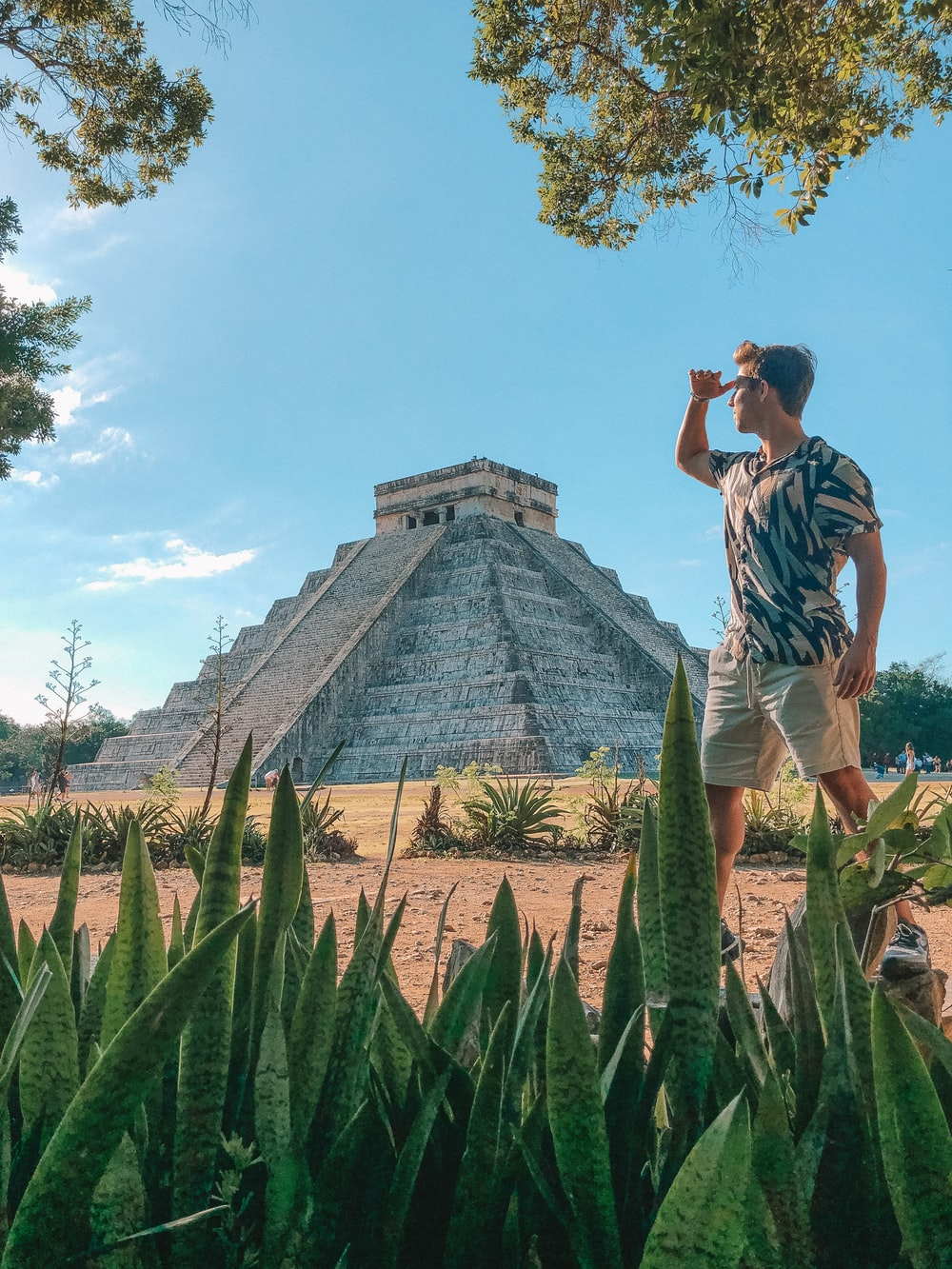 man standing in front of Chichen Itza, Mexico during daytime