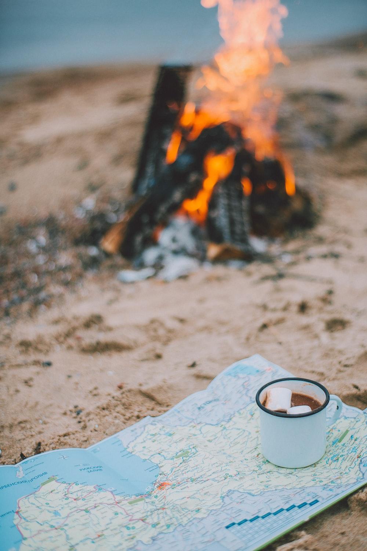white cup near bonfire