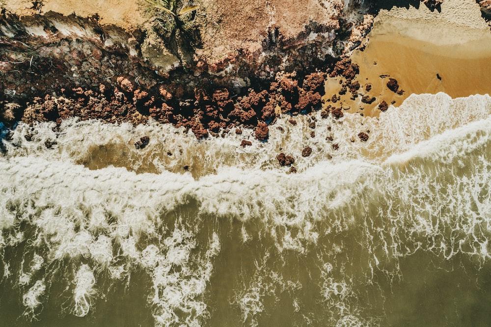 sea wave near beach cliff