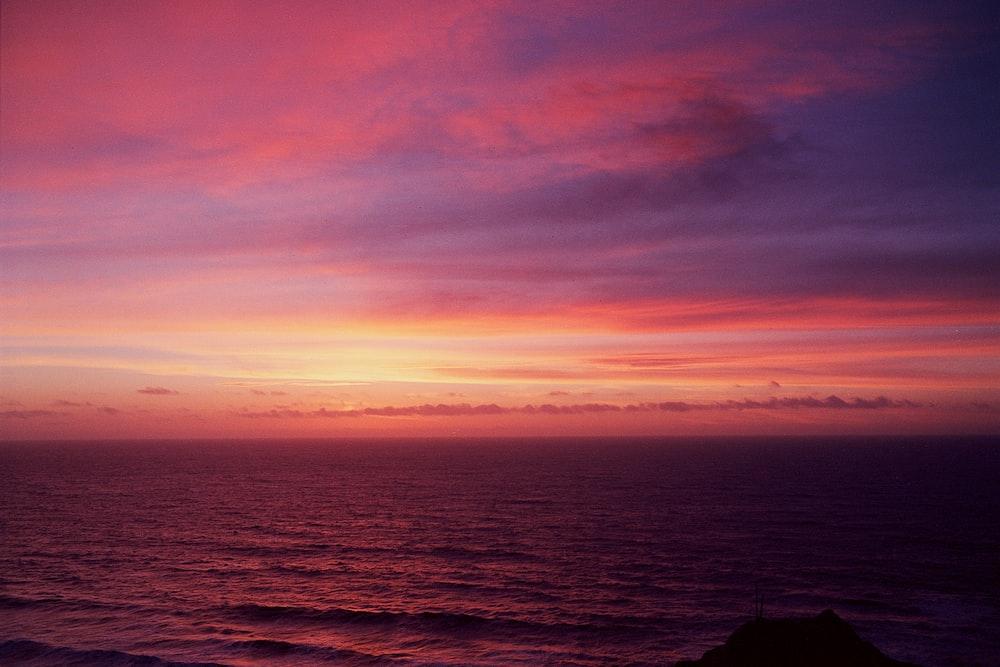 blue seawater during sunset