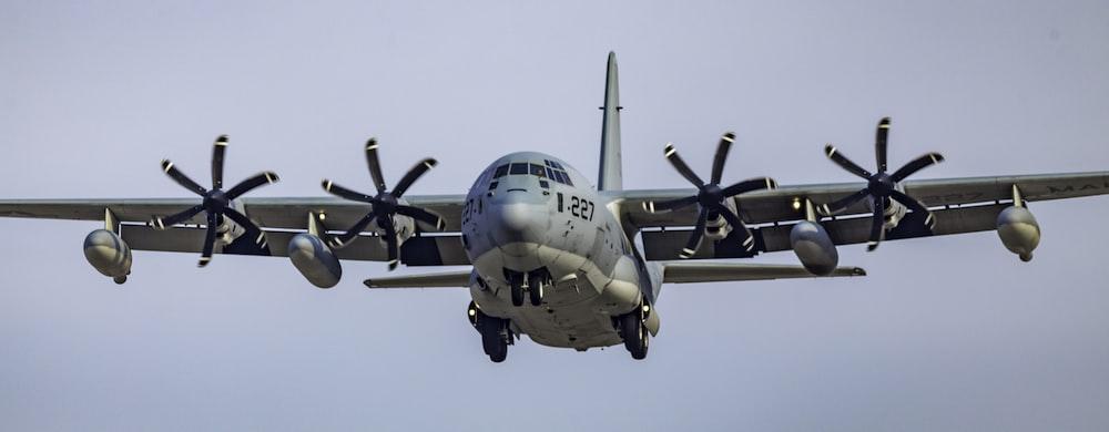 gray fighter jet on flight during daytime