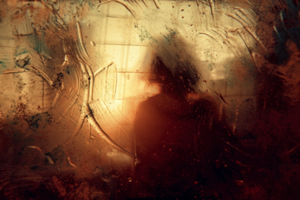 woman sitting near amber glass