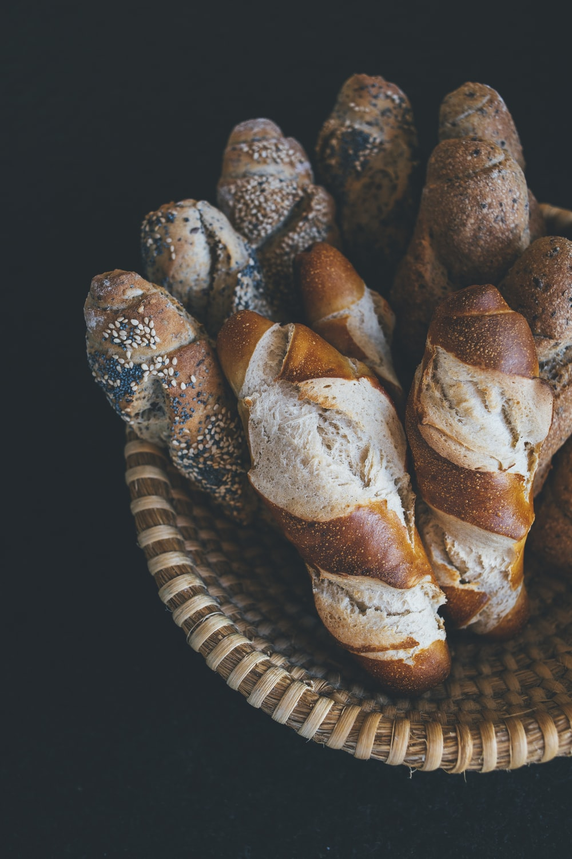 baked bread on brown wicker bowl