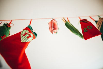 stockings and loot bags hanged on red rope stocking teams background