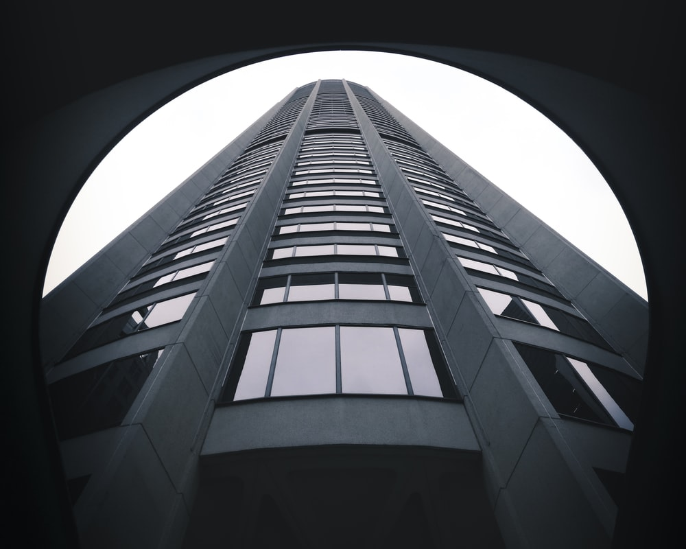 low-angle photography of gray building