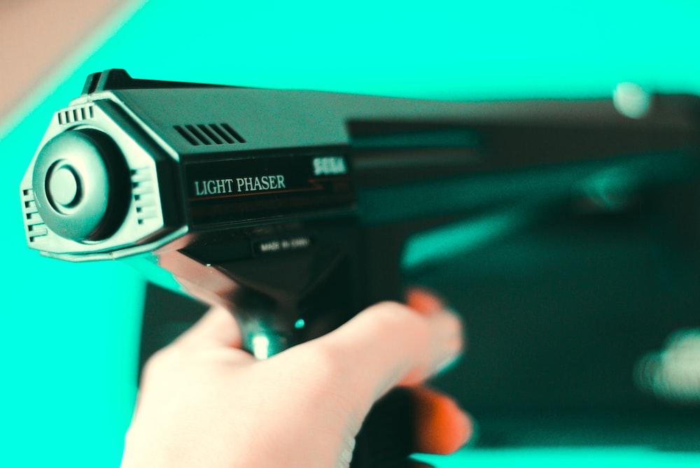 person holding black light phaser