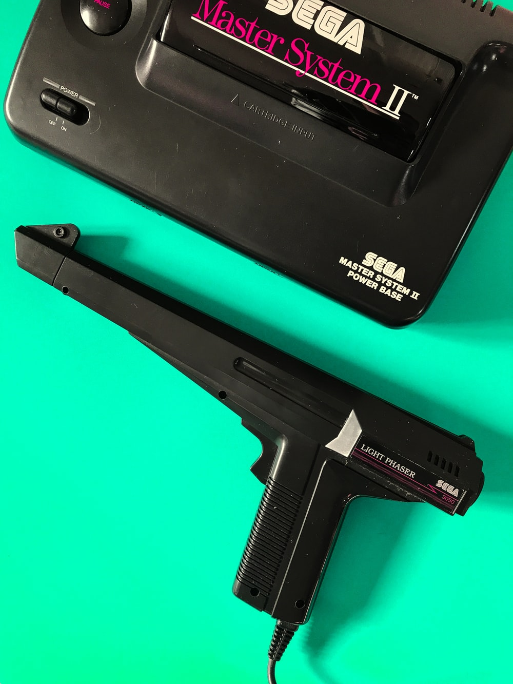 black Sega master system ll console with controller