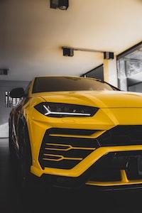 yellow vehicle parked inside garage