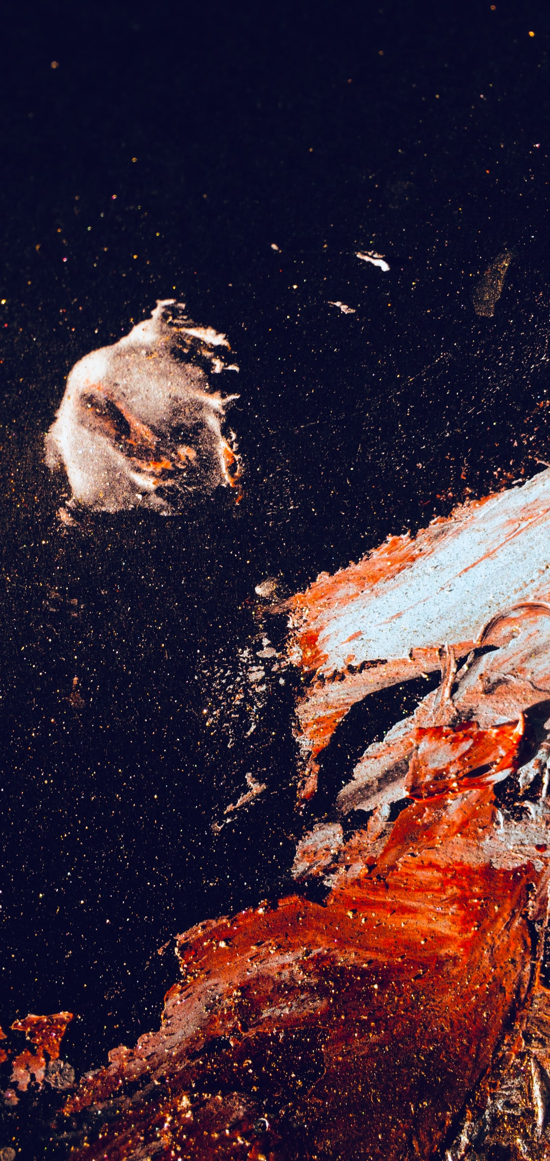 An abstract painting drawn in two colors: light blue and red. After the staining step, to enhance the charm and glitter of the photo, it is scratched on it. In the picture, they look like stars.