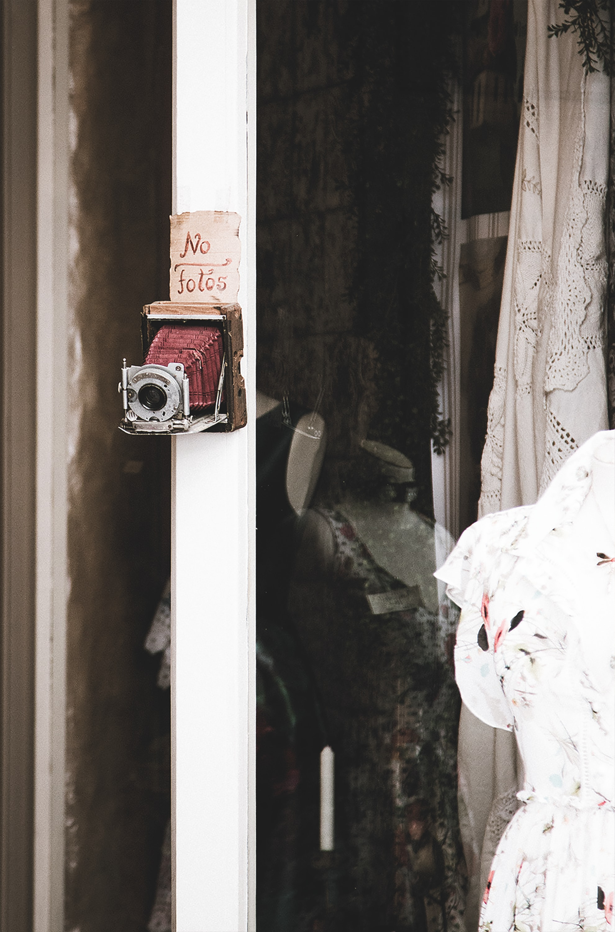 red and gray camera on wall