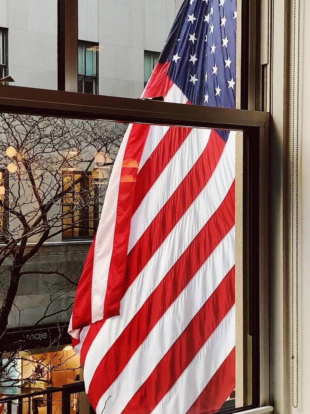 American flag outside window
