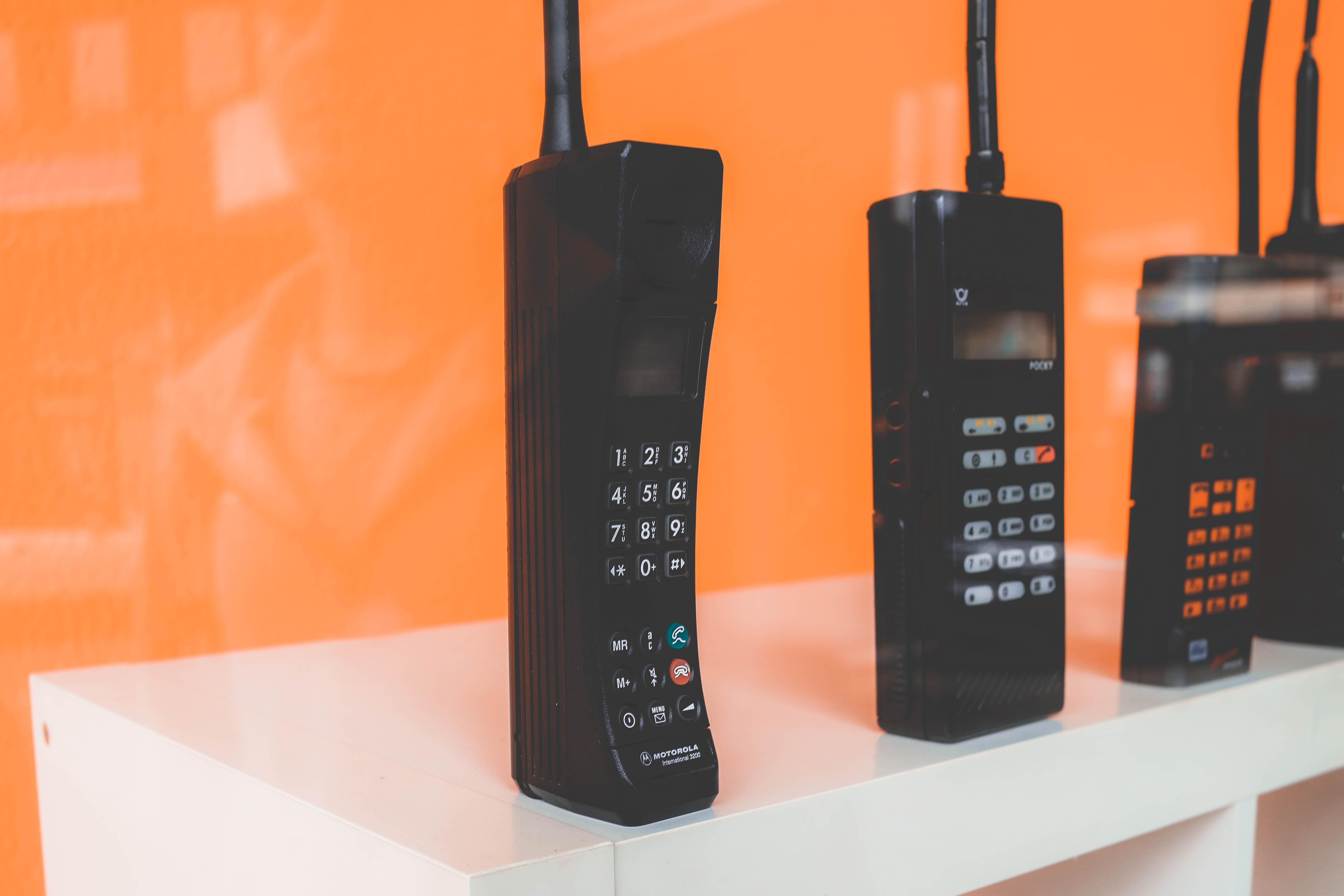 black home phones on white rac k
