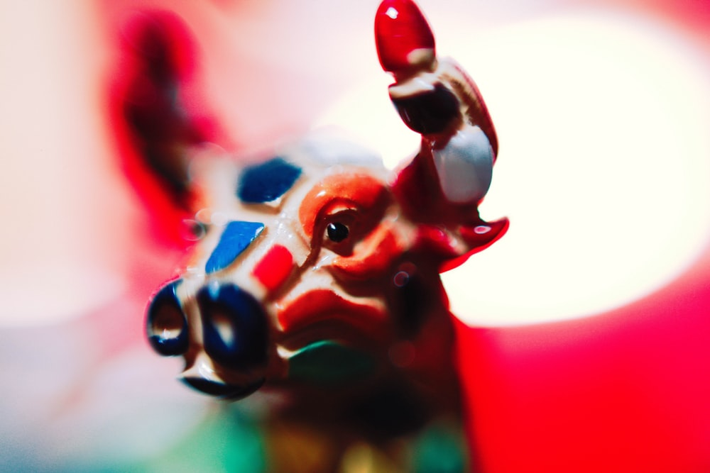 macro photography of brown and white bull figurine