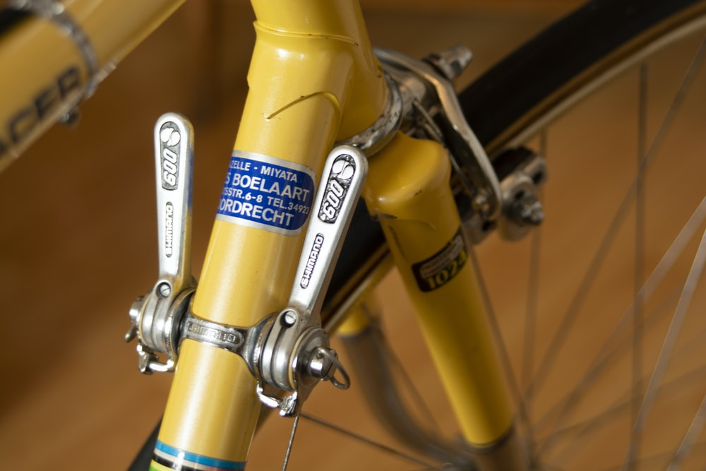 yellow and gray stainless steel bike