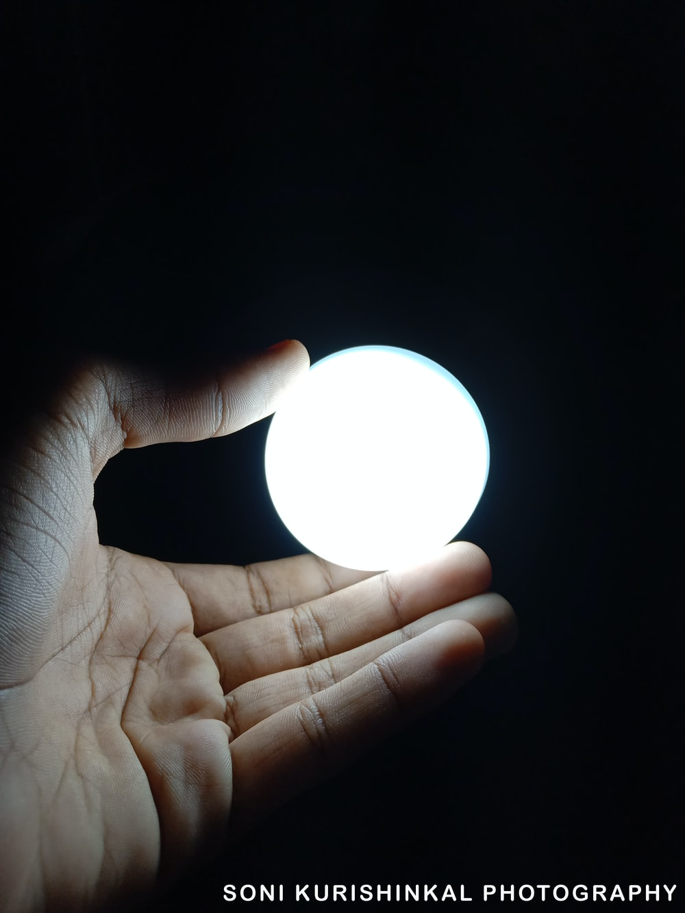 person holding ball of light