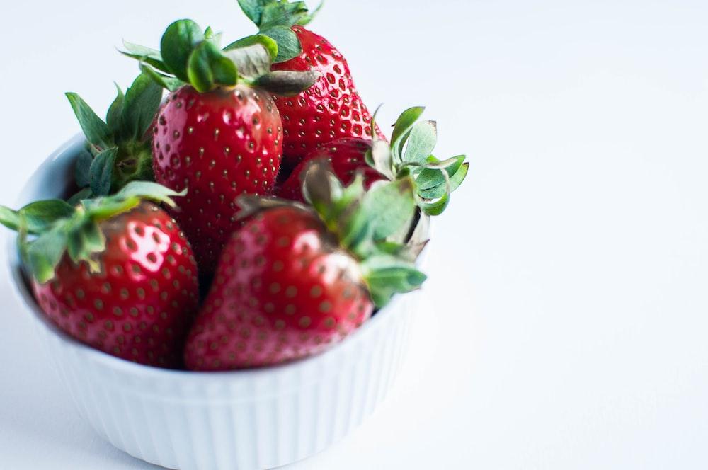 red strawberries in white ramekin